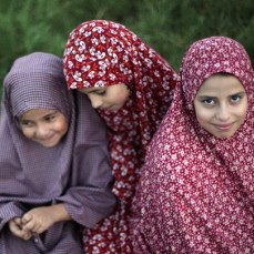 Veiled Palestinian girls attend Eid al-Adha prayers in a public garden in Gaza City, Thursday, Sept. 24, 2015. Muslims will slaughter cattle and goats later, with the beef and meat distributed to the needy in the holiday which honors the prophet Abraham for preparing to sacrifice his son on the order of God, who was testing his faith. (AP Photo/ Khalil Hamra)